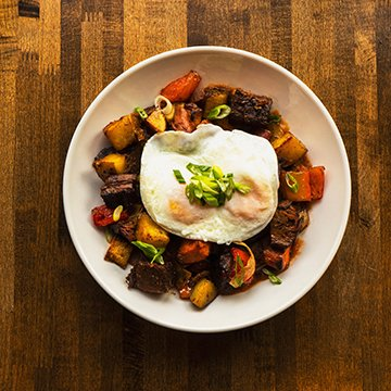 Bruncheonette Smoked Brisket Hash with Smoked Brisket, Country Potato Medley, Onion, Red Bell Pepper, Smoked Tomato Sauce, and 2 Eggs